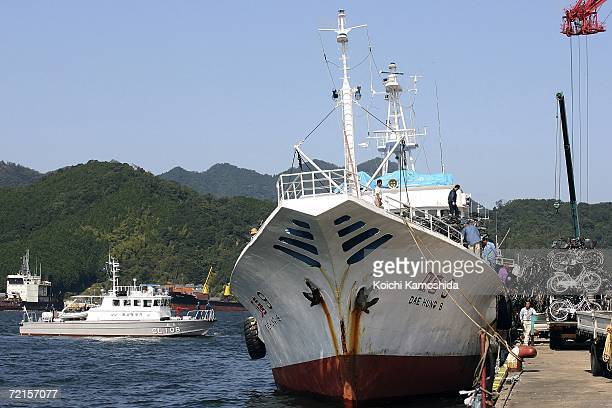North Korean ship packs a load of used bicycles and refrigerators while a Japanese Coast Guard boat stands watch at the Maizuru port October 13 2006...