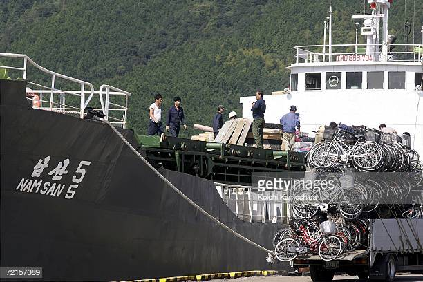 North Korean ship packs a load of used bicycles and refrigerators at the Maizuru port October 13 2006 in Maizuru Japan The Japanese government has...