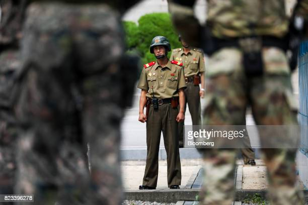 A North Korean soldier center looks towards the South Korean side of the truce village of Panmunjom in the Demilitarized Zone in Paju South Korea on...