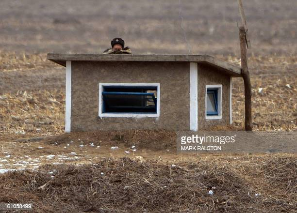 A North Korean soldier keeps watch over the border area near the Chinese town of Dujiagou on February 9 2013 US Secretary of State John Kerry warned...