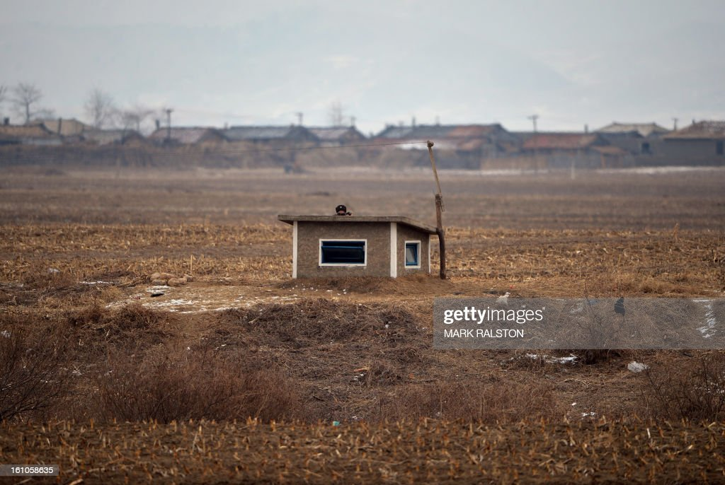 A North Korean soldier keeps watch over the border area near the Chinese town of Dujiagou on February 9, 2013. US Secretary of State John Kerry warned that North Korea's expected nuclear tests only increase the risk of conflict and would do nothing to help the country's stricken people. The country has vowed to carry out a third nuclear test soon, and concerns have been raised over the type of fissile material used in the device. AFP PHOTO/Mark RALSTON