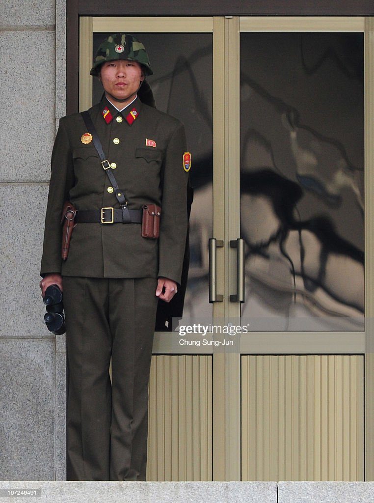 A North Korean soldier looks at South Korea across the Korean Demilitarized Zone (DMZ), on April 23, 2013 in Panmunjom, South Korea. The tension at Korean Peninsula remains high as North Korea's ballistic missiles have been ready to launch ahead of North Korean Army foundation celebration day on April 25.