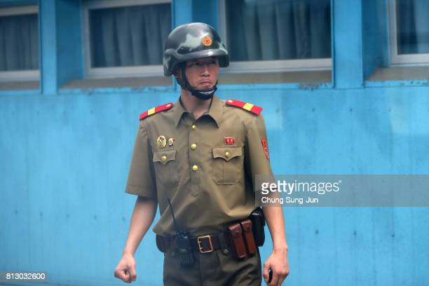 North Korean soldier looks at South Korea across the Korean Demilitarized Zone on July 12 2017 in Panmunjom South Korea South Korea Japan and the...