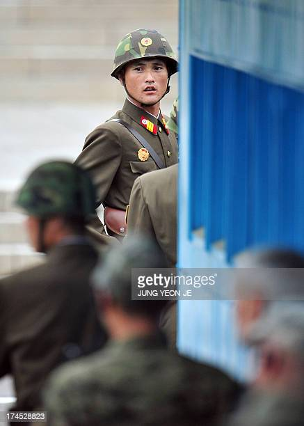 A North Korean soldier looks at the South side as government delegations from the UN allied nations visit the truce village of Panmunjom in the...