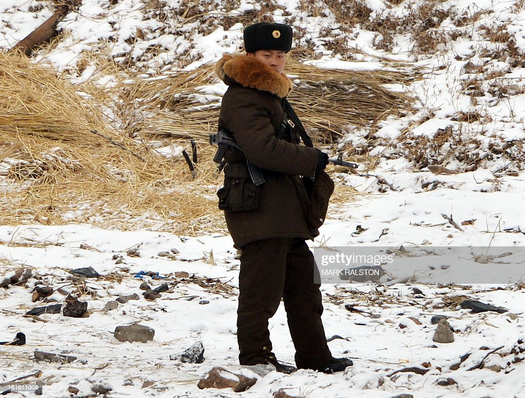 A North Korean soldier patrols the banks of the Yalu River at the North Korean town of Sinuiju across from the Chinese city of Dandong on February 13, 2013. While the rest of the world reacted with outrage, North Koreans were swept up in a 'storm of excitement' over their country's latest nuclear test, state media reported. The countries third nuclear test was widely condemned by the international community, led by the United States and the UN Security Council, which met in emergency session the same day. AFP PHOTO/Mark RALSTON