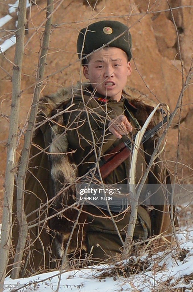 A North Korean soldier reacts as he patrols along the Yalu River near the North Korean town of Sinuiju after the country conducted it's third nuclear test on February 12, 2013. North Korea confirmed on February 12 it had 'successfully' carried out an underground nuclear test, drawing immediate condemnation from rival South Korea. AFP PHOTO/Mark RALSTON