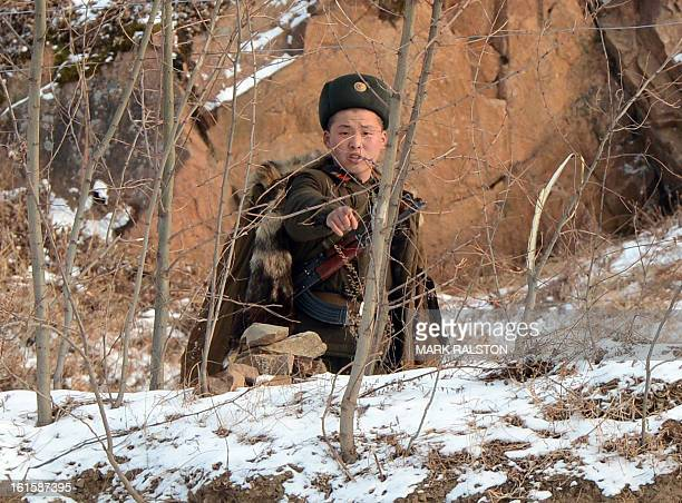 A North Korean soldier reacts as he patrols along the Yalu River near the North Korean town of Sinuiju after the country conducted it's third nuclear...