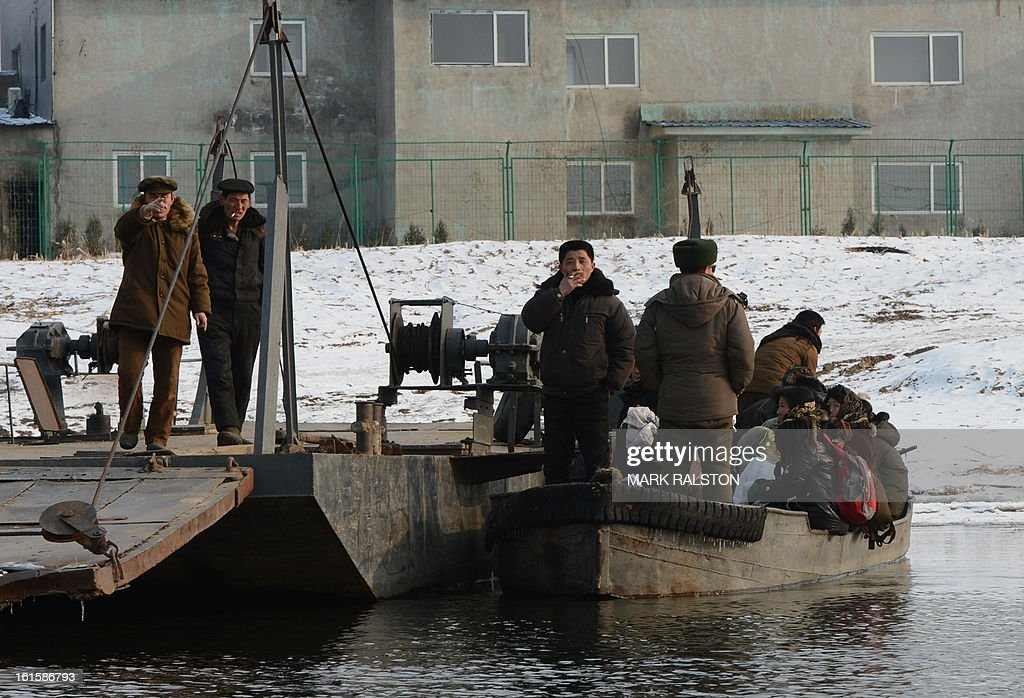 A North Korean soldier reacts as North Korean's prepare to make a river crossing on the Yalu River near the North Korean town of Sinuiju after the country conducted it's third nuclear test on February 12, 2013 across from the Chinese city of Dandong. North Korea staged its most powerful nuclear test yet on February 12, claiming a breakthrough with a 'miniaturised' device in a striking act of defiance to global powers including its sole patron China. AFP PHOTO/Mark RALSTON