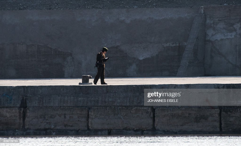 A North Korean soldier reads a book on the banks of the Yalu River at the town of Sinuiju across from the Chinese border town of Dandong on February 10, 2016. North Korea has restarted a plutonium reactor that could fuel a nuclear bomb and is seeking missile technology that could threaten the United States, Washington's top spy said. AFP PHOTO / JOHANNES EISELE / AFP / JOHANNES EISELE