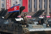 A North Korean soldier salutes from a tank during a military parade past Kim IlSung square marking the 60th anniversary of the Korean war armistice...