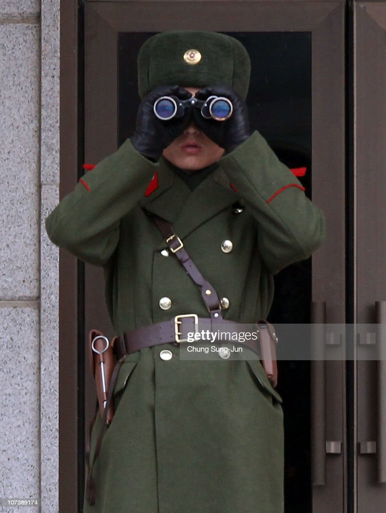 North Korean soldier stands guard as the border town reopens following North Korea's attack on Yeonpyeong in late November on December 8 2010 in...