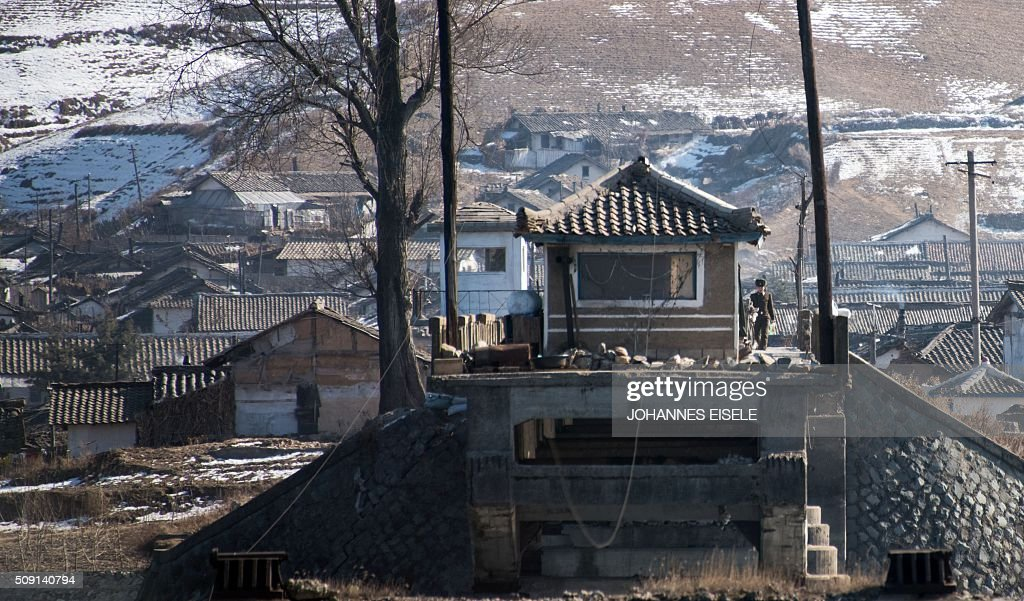 A North Korean soldier stands guard at a post on a destroyed bridge on the North Korean side of the border, seen from Changhe Island near the Chinese border town of Dandong on February 9, 2016. The rocket launched by North Korea at the weekend seemed more powerful than its 2012 predecessor, but Pyongyang still lacks the expertise to transform it into a ballistic missile capable of reaching the US mainland, South Korean officials said on February 9. AFP PHOTO / JOHANNES EISELE / AFP / JOHANNES EISELE