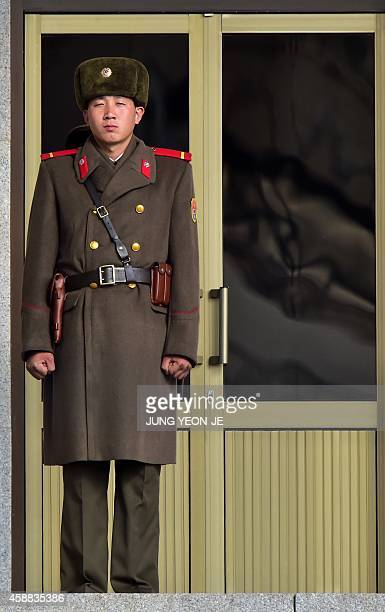 A North Korean soldier stands guard at the North side of the truce village of Panmunjom in the Demilitarized Zone dividing the two Koreas on November...