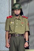 A North Korean soldier stands guard at the truce village of Panmunjom in the Demilitarized zone dividing the two Koreas on July 22 2015 North Korea...
