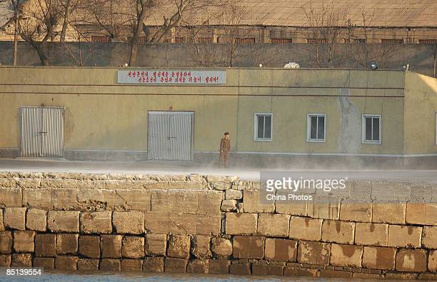 A North Korean soldier stands guard in a military barracks on the banks of the Yalu River near the North Korean town of Sinuiju opposite Chinese...