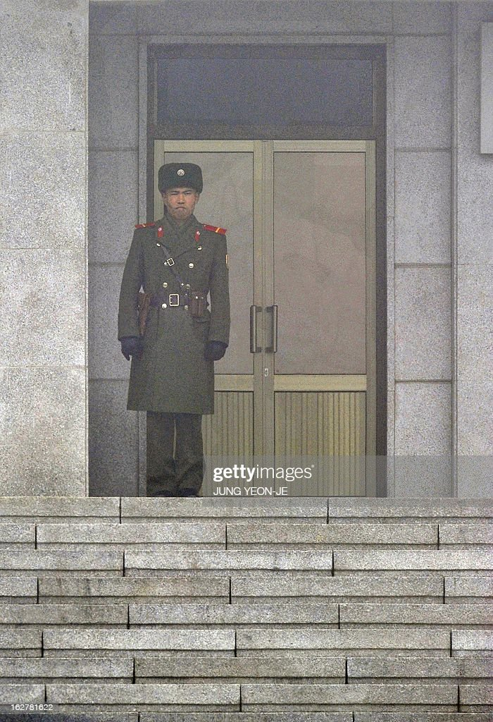 A North Korean soldier stands guard in fog at the truce village of Panmunjom in the demilitarized zone dividing North and South Korea on February 27, 2013. North Korean leader Kim Jong-Un oversaw a live-fire artillery drill aimed at simulating an 'actual war', state media said on February 26, a day after South Korea swore in its first female president.