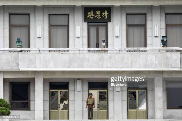A North Korean soldier stands guard in front of the Panmungak building at the truce village of Panmunjom in the Demilitarized Zone in Paju South...