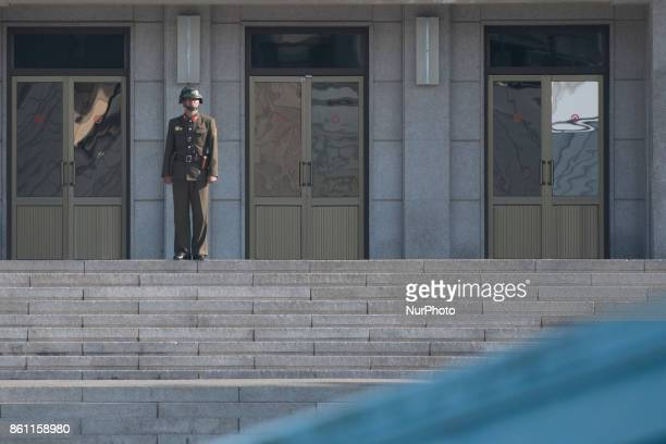 A North Korean soldier stands guard in the border village of Panmunjom between South and North Korea at the Demilitarized Zone on October 14 2017 in...