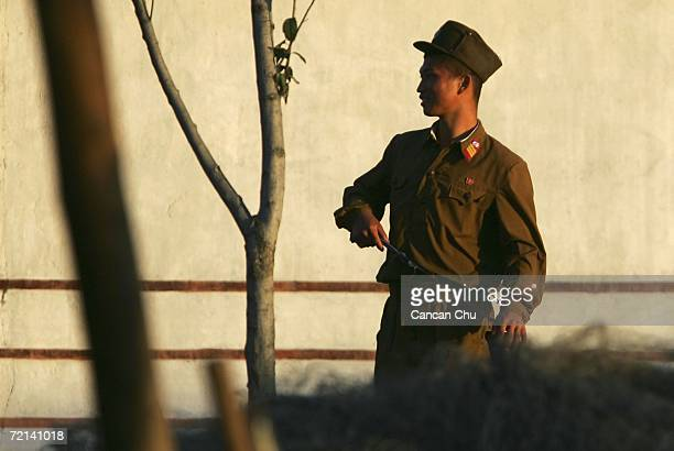 North Korean soldier stands guard on the banks of the Yalu River in the North Korean town of Sinuiju opposite the Chinese border city of Dandong...
