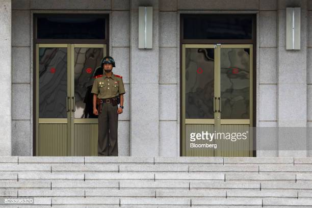 A North Korean soldier stands guard outside the Panmungak building at the truce village of Panmunjom in the Demilitarized Zone in Paju South Korea on...