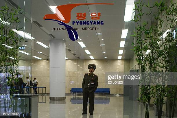 A North Korean soldier stands in the arrivals hall of Pyongyang's International airport on October 8 2015 North Korea is gearing up for a lavish...