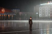 A North Korean soldier stands in the rain on Kim IlSung square following a mass military parade in Pyongyang on October 10 2015 North Korea was...