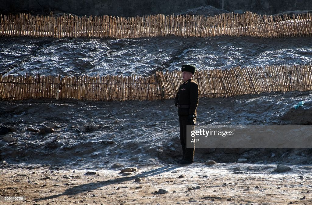 A North Korean soldier stands on the banks of the Yalu River at the North Korean town of Sinuiju, as seen from across the river from the Chinese border town of Dandong on February 9, 2016. The rocket launched by North Korea at the weekend seemed more powerful than its 2012 predecessor, but Pyongyang still lacks the expertise to transform it into a ballistic missile capable of reaching the US mainland, South Korean officials said on February 9. AFP PHOTO / JOHANNES EISELE / AFP / JOHANNES EISELE