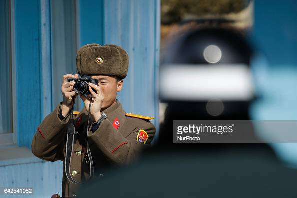 North Korean soldier take a picture to Australia Foreign Minister Julie Bishop at truce village Panmunjom in Paju South Korea on February 18 2017