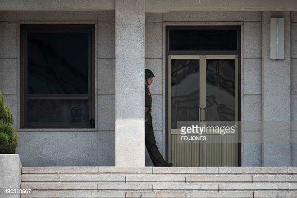 A North Korean soldier walks along his side of the truce village of Panmunjom in the Demilitarized Zone between North and South Korea on May 14 2014...