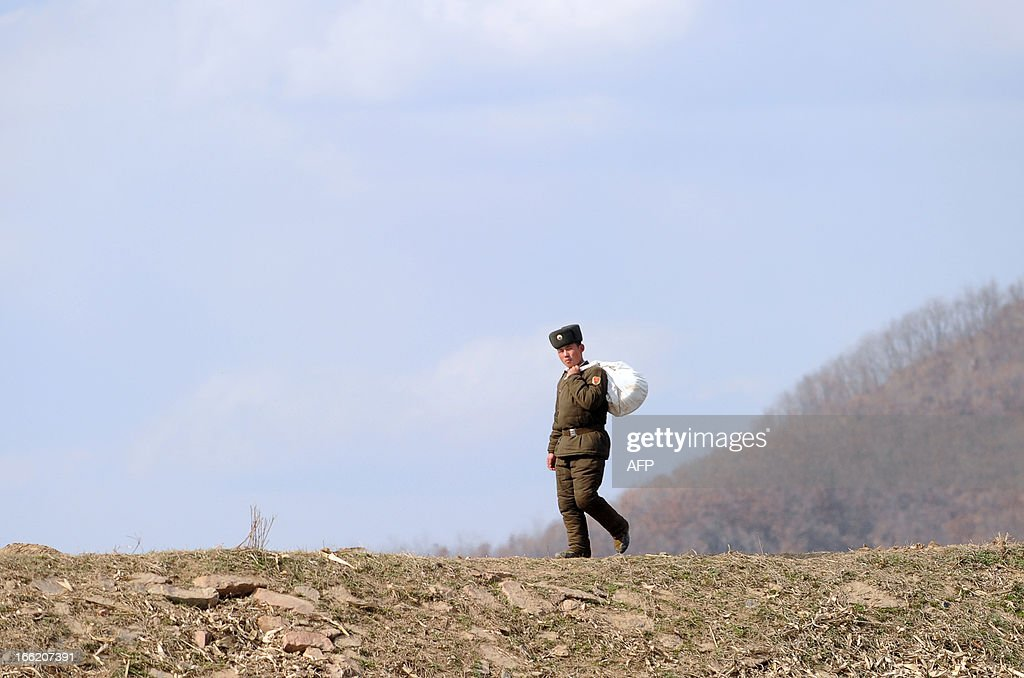 A North Korean soldier walks on the banks of the Yalu River at the North Korean town of Sinuiju across from the Chinese city of Dandong, northeastern Liaoning province on April 10, 2013. The biggest border crossing between North Korea and China has been closed to tourist groups, a Chinese official said on April 10 as nuclear tensions mounted, but business travel was still allowed.