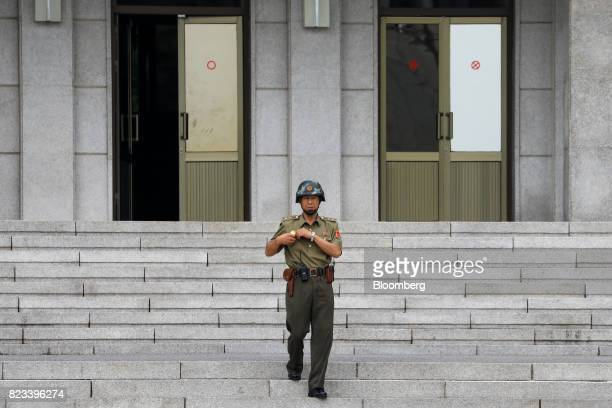 A North Korean soldier walks toward the southern side of the truce village of Panmunjom in the Demilitarized Zone in Paju South Korea on Thursday...