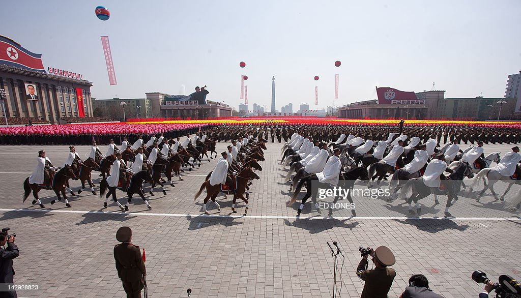 North Korean soldiers and horses are displayed during a military parade in honour of the 100th birthday of the late North Korean leader Kim Il-Sung in Pyongyang on April 15, 2012. North Korea's new leader Kim Jong-Un delivered his first public speech and vowed to push for 'final victory' for his impoverished state despite a failed rocket launch two days ago, as the country celebrated the 100th anniversary of former leader Kim Il-Sung. AFP PHOTO / Ed Jones