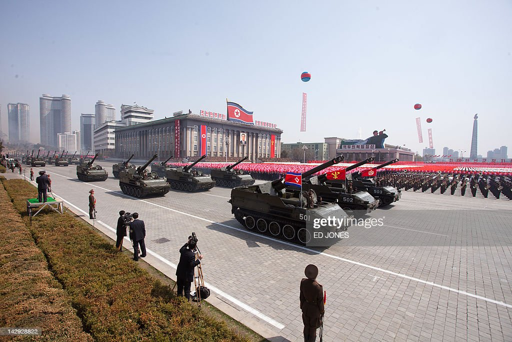 North Korean soldiers and tanks are displayed during a military parade in honour of the 100th birthday of the late North Korean leader Kim Il-Sung in Pyongyang on April 15, 2012. North Korea's new leader Kim Jong-Un delivered his first public speech and vowed to push for 'final victory' for his impoverished state despite a failed rocket launch two days ago, as the country celebrated the 100th anniversary of former leader Kim Il-Sung. AFP PHOTO / Ed Jones