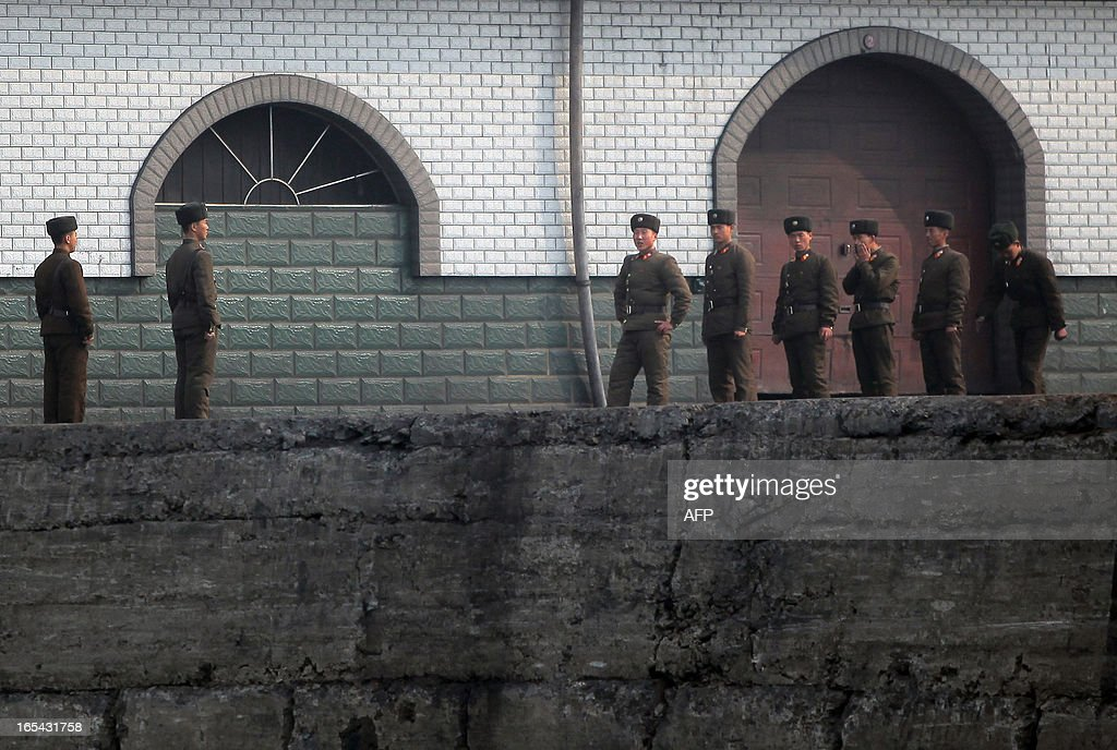 North Korean soldiers assemble by the docks in the North Korean town of Sinuiju across from the Chinese city of Dandong on April 4, 2013. North Korea appears to have moved a medium range missile to its east coast, South Korean Defence Minister Kim Kwan-Jin said, prompting fears of a strike against South Korea or Japan. CHINA