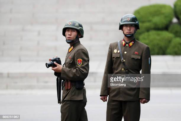 North Korean soldiers look across to the South Korean side of the truce village of Panmunjom in the Demilitarized Zone in Paju South Korea on Monday...