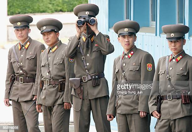 North Korean soldiers look at the south side as Crown Prince Philippe of Belgium visits the border in the village of Panmunjom between South and...