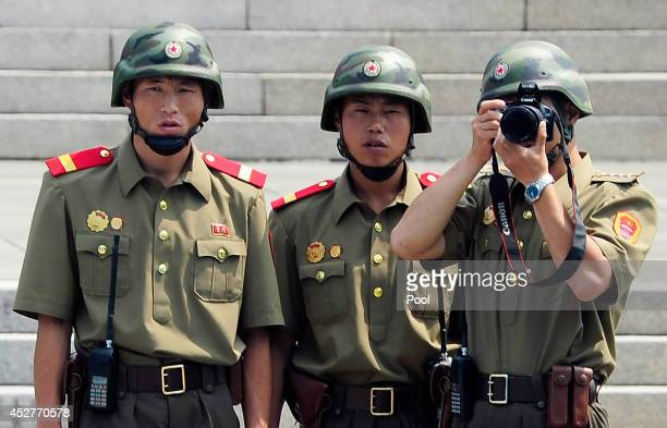 North Korean soldiers look at the South side during a ceremony marking the 61th anniversary of the signing of the armistice agreement on July 27 2014...