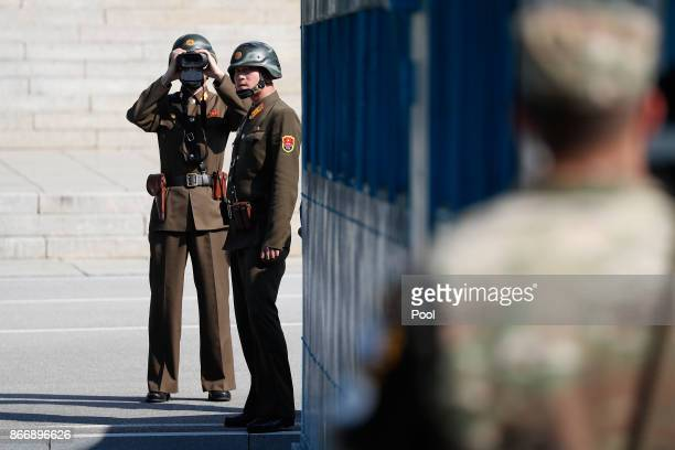 North Korean soldiers look at the South side while US Defense Secretary Jim Mattis and South Korean Defense Minister Song Youngmoo visit at the truce...