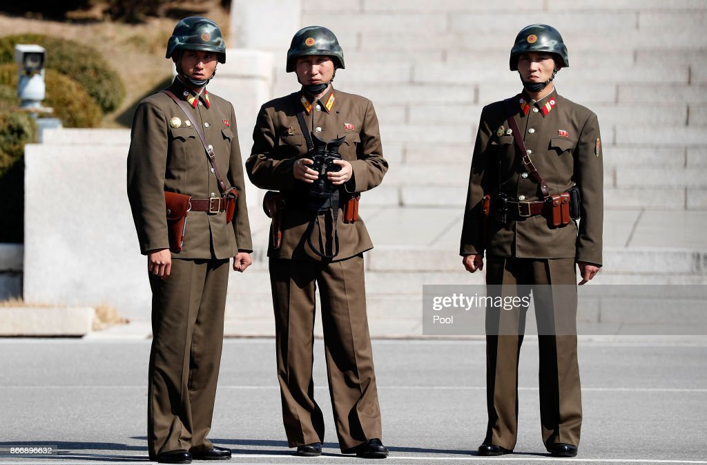 North Korean soldiers look at the South side while U.S. Defense Secretary Jim Mattis and South Korean Defense Minister Song Young-moo visit at the truce village of Panmunjom in the Demilitarized Zone (DMZ) on October 27, 2017 in Panmunjom, South Korea. Mattis is in South Korea ahead of the visit by U.S. President Donald Trump.