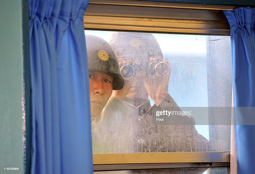 North Korean soldiers look in from outside the UN Command Military Armistice Commission meeting room as newly appointed commander General James Thurman (not in picture), commander of the United Nations Comand (UNC), Combined Forces Command (CFC), and United States Forces Korea (USFK) visit to the border village of Panmunjom on July 15, 2011 in Panmunjom, South Korea. Thurman was appointed on Thursday as the commander of 28,500 American troops in South Korea in his capacity as commander of United States Forces Korea.