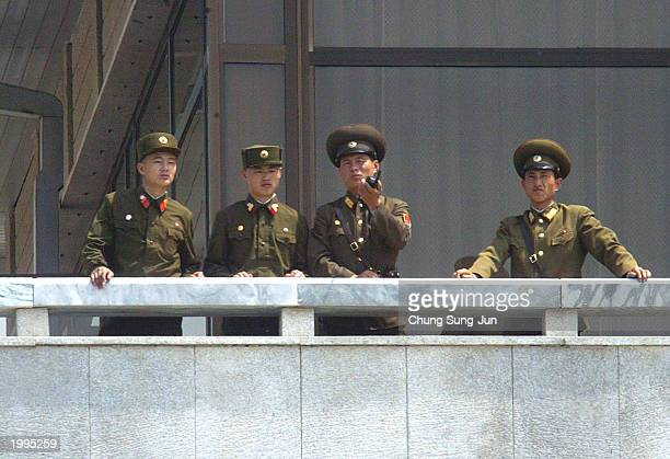 North Korean soldiers look over to the southern area May 13 2003 at the border village of Panmunjom in the demilitarized zone between the two Koreas...