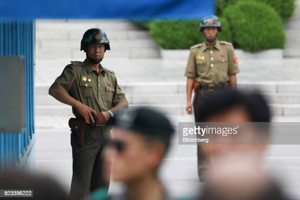 North Korean soldiers look towards the South Korean side of the truce village of Panmunjom in the Demilitarized Zone in Paju South Korea on Thursday...