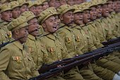 North Korean soldiers march during a mass military parade at Kim IlSung square in Pyongyang on October 10 2015 North Korea was marking the 70th...
