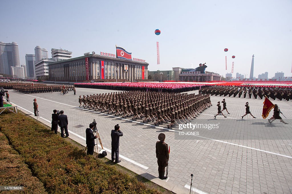 North Korean soldiers march during a military parade in honour of the 100th birthday of the late North Korean leader Kim Il-Sung in Pyongyang on April 15, 2012. North Korea's new leader Kim Jong-Un delivered his first public speech and vowed to push for 'final victory' for his impoverished state despite a failed rocket launch two days ago, as the country celebrated the 100th anniversary of former leader Kim Il-Sung. AFP PHOTO / Ed Jones