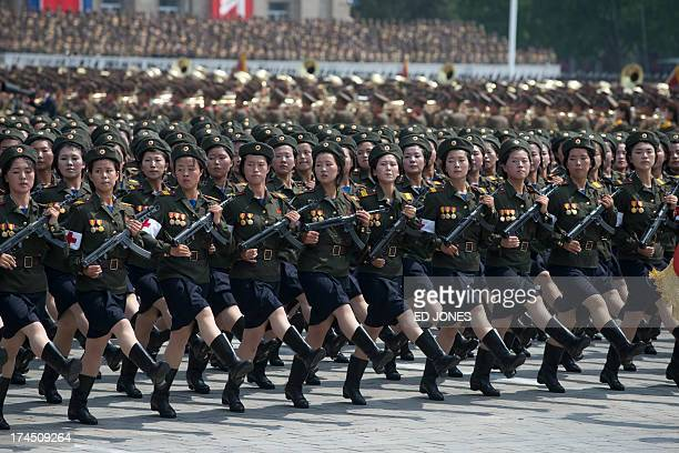 North Korean soldiers march during a military parade past Kim IlSung square marking the 60th anniversary of the Korean war armistice in Pyongyang on...