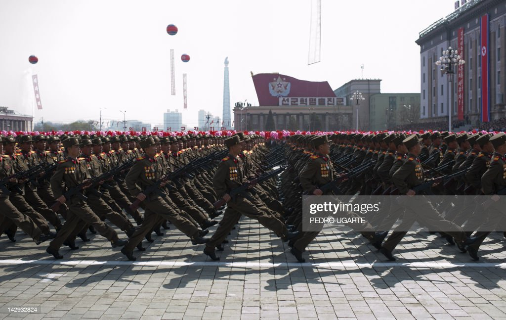 North Korean soldiers march during a military parade to mark 100 years since the birth of North Korea's founder Kim Il-Sung in Pyongyang on April 15, 2012. North Korea's new leader Kim Jong-Un delivered his first public speech on April 15 and vowed to push for 'final victory' for his impoverished state despite a failed rocket launch two days ago.