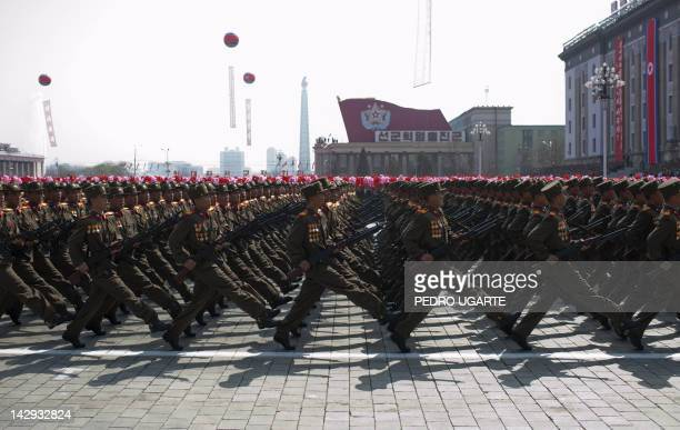 North Korean soldiers march during a military parade to mark 100 years since the birth of North Korea's founder Kim IlSung in Pyongyang on April 15...