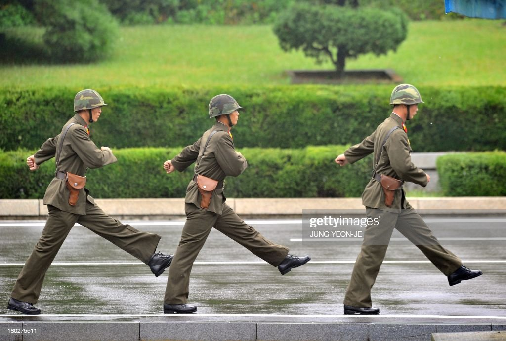 North Korean soldiers march during a repatriation ceremony for the body of a North Korean soldier, who was found dead in the Han river near the border in July, during a repatriation ceremony at the truce village of Panmunjom in the Demilitarized zone dividing the two Koreas on September 11, 2013. The ceremony was supervised by United Nations officials who have been monitoring the truce since the 1950-53 Korean War.