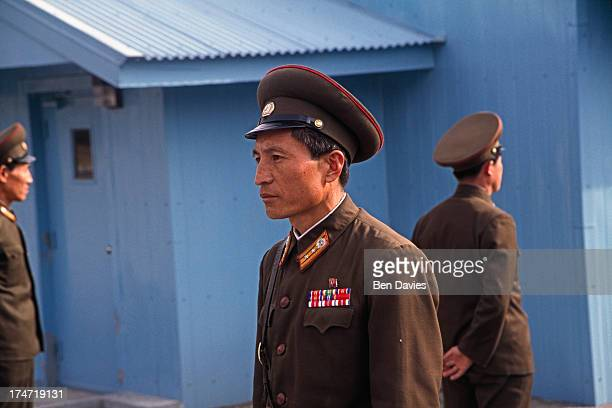 North Korean soldiers monitor the demilitarized zone at Panmunjom the line which separates North and South Korea The DMZ line is one of the most...