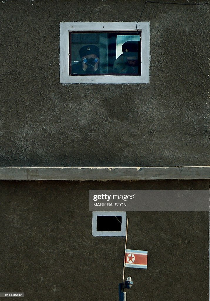 North Korean soldiers monitor the Yalu River from a guard tower at the North Korean town of Sinuiju on February 11, 2013 across from the Chinese city of Dandong. A North Korean state media outlet has accused the United States of 'jumping to conclusions' that the North would soon stage a nuclear test, adding to the confusion over its immediate intentions. The US and its ally South Korea are 'fussing over speculation' without knowing exactly what action the North plans to take, Tongil Sinbo, a Japan-based pro-North weekly magazine funded by Pyongyang, said. AFP PHOTO/Mark RALSTON